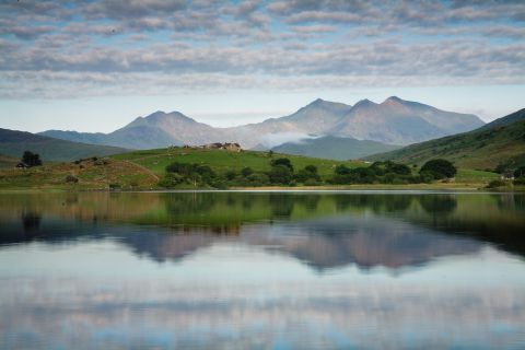 Snowdon mountain range reflecting in lake