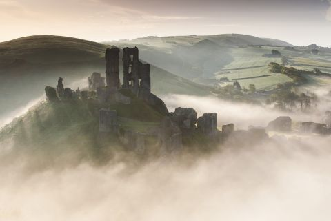 Corfe castle rising from the mist
